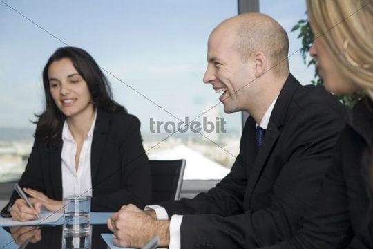 Fun at work, a business man laughing during an advisory meeting