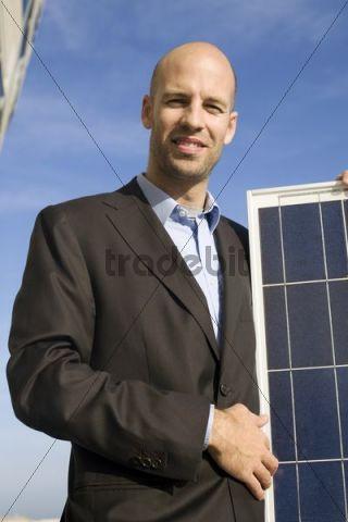 Salesman with solar panel