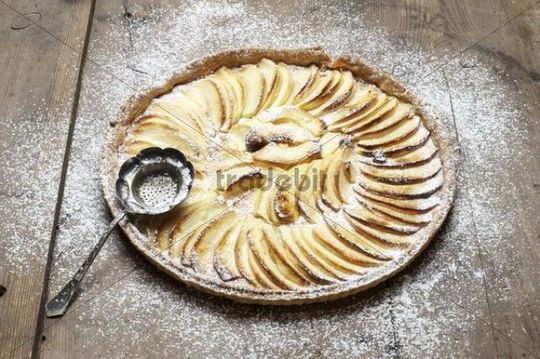 Apple pie, apple tart from shortcrust with powdered sugar
