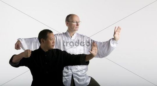 German-Chinese friendship, two Taiji masters, classical Taiji position, Chansi Gong, Western Europe meets Asia, in traditional Taiji Jackets