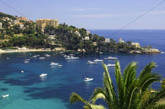 A picturesque bay with boats on the Mediterranean Sea at Cap d´Ail, Côte d´Azur, France, Europe