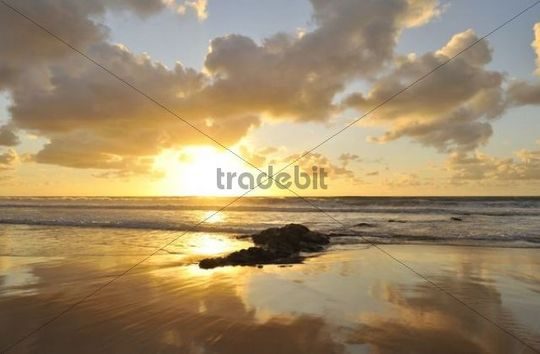 Sunset and cloudy sky with reflection on the Atlantic Ocean, El Cotillo, Fuerteventura, Canary Islands, Spain, Europe