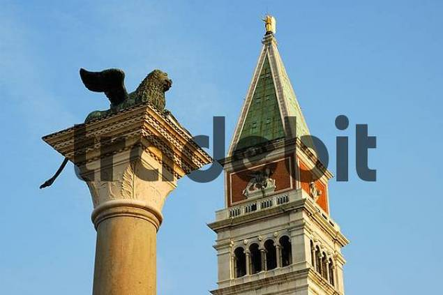 San Marco clocktower, column of the lion of Saint Mark, Piazzetta, Venice Italy
