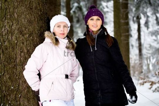 Two young women in a winter forest
