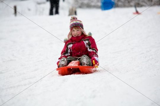 Sledding 4-year-old girl