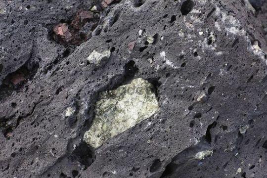 Olivine enclosed in lava, Lanzarote, Canary Islands, Spain, Europe