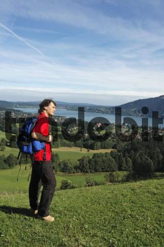 view from the Bucherer Berg to the Tegernsee from the way to the Bauer in der Au Bavaria Germany