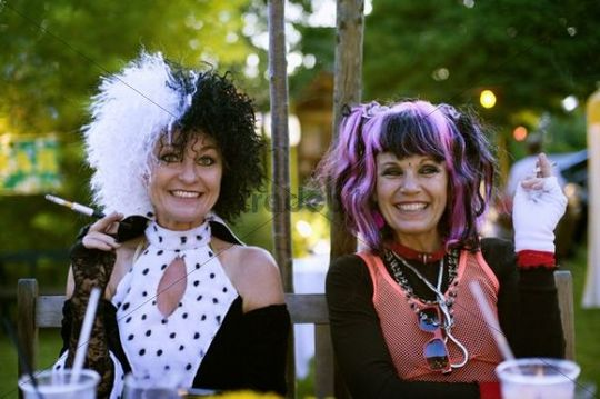 Two women are dressed up as Nina Hagen and Glenn Close as the witch Cruella DeVil