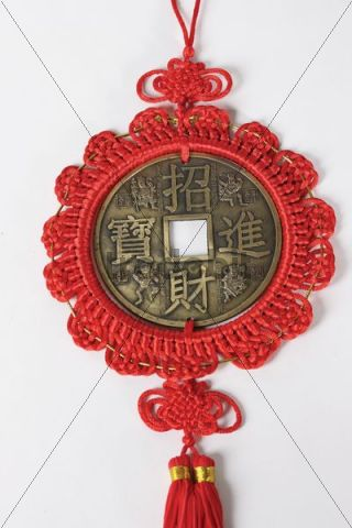 Chinese knot with a Chinese coin in it