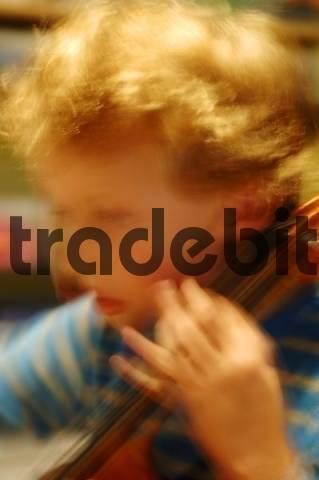 Boy playing cello, violoncello