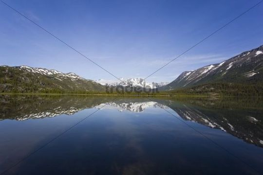 Reflection of mountains in calm Lake Lindemann, historic Lindeman City, Chilkoot Trail, Chilkoot Pass, Yukon Territory, British Columbia, B. C., Canada