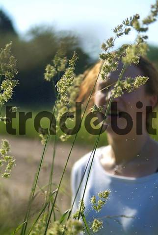 young woman with hay fever reacts allergic to grass and pollen dactylis