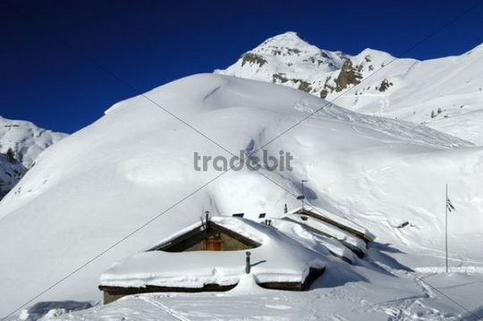Snow-covered mountain huts on the alp Petit Pre, Mt Dent Favre in the back, Ovronnaz, Valais, Switzerland, Europe