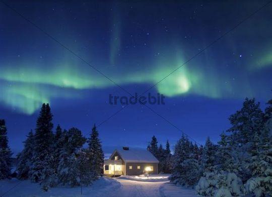 Aurora above illuminated house, Sweden, Scandinavia, Europe