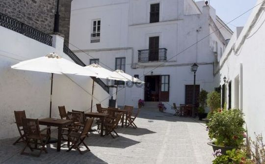 Little alleyway with seats of a restaurant in the small town of Vejer de la Frontera, Andalusia, Spain, Europe