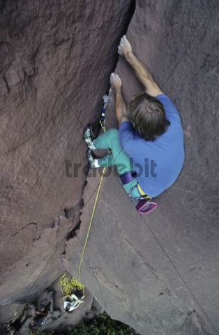 Sports climber climbing a crack in a crag, Klettergarten Hainstadt, Odenwald, Hesse, Germany, Europe