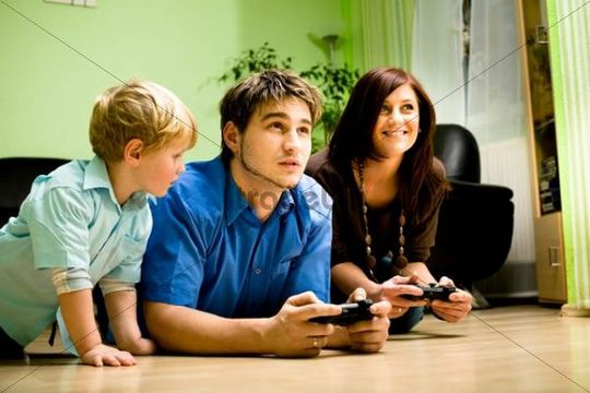 Young family playing with a game console