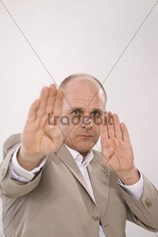 Man holding both hands in front of him