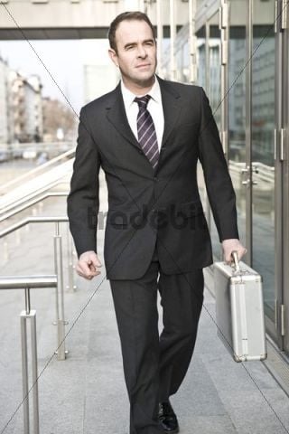 Manager passing an office building