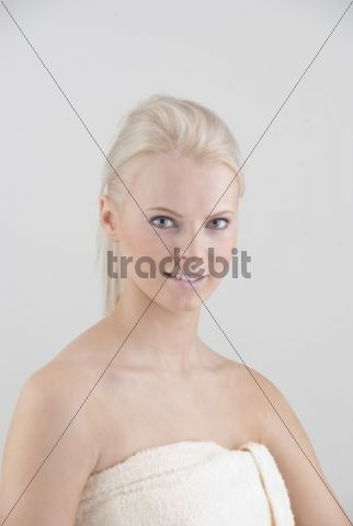 Young woman with bath towel, portrait