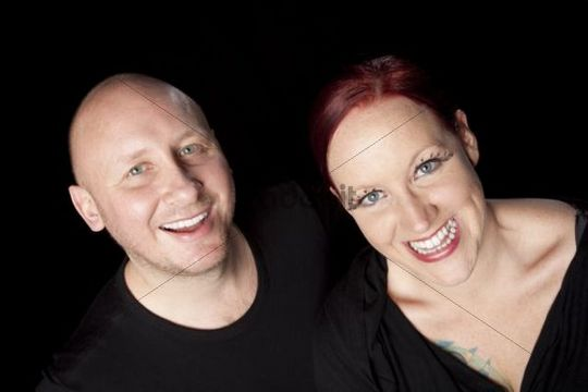Bald man and red-haired woman