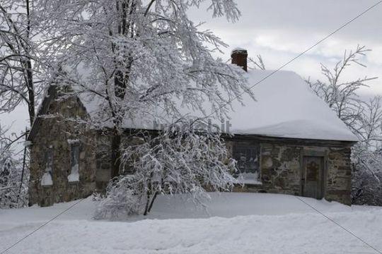 Snowy stone house, winter, Canada