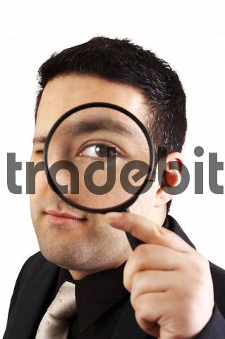 Man with a magnifier glass. The auditor
