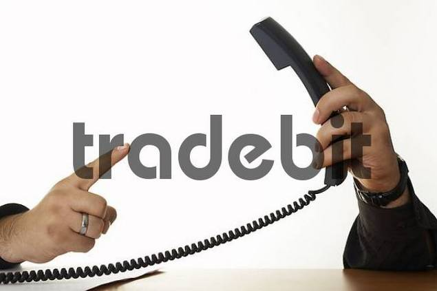 finger pointing to a telephone receiver