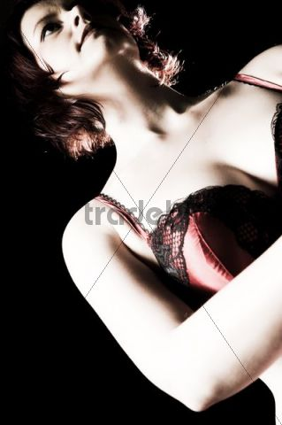 Red-haired woman in underwear