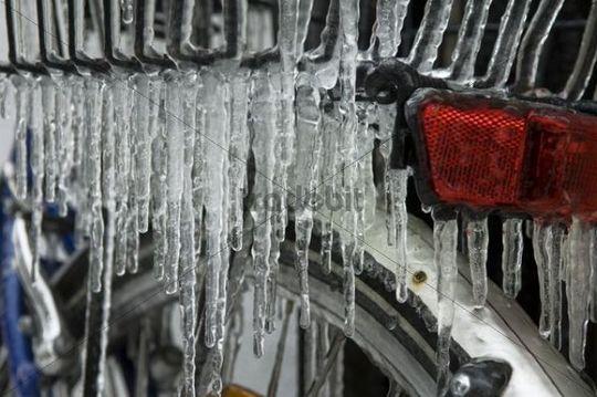 Freezing rain, icicles on a bike, details
