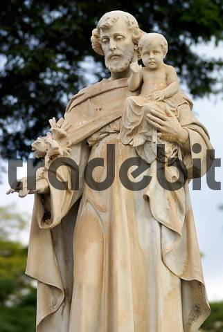 Statue of Saint Antony holding a Lily and the infant Jesus in his hands, graveyard quotConceioquot, So Paulo, Brazil