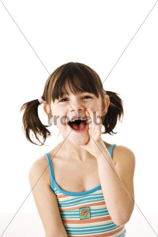 Smiling little girl with pigtails calling