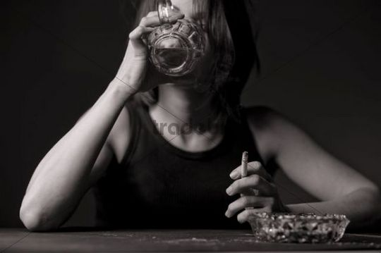 Woman with beer and cigarette