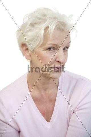 A mature woman winking