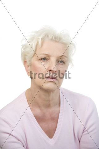 A mature woman with sad expression