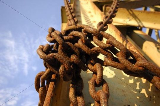 Rusty chains around a steel beam