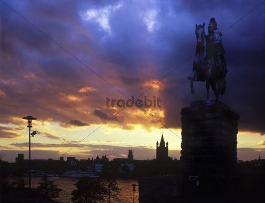 View from Deutz, Gross St. Martin church, equestrian statue of Kaiser Wilhelm I of Prussia, Cologne Cathedral and Hohenzollernbruecke bridge, blue hour, evening, illuminated, Cologne, North Rhine-