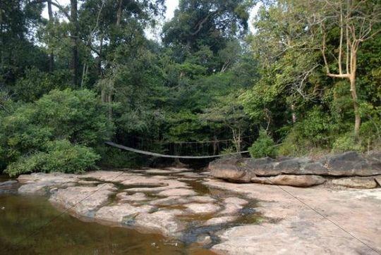 Suspension bridge over jungle stream, rocky creek bed, Phou Khao Khouay National Protected Area, Bolikhamsai or Borikhamxay Province, Laos, Southeast Asia, Asia