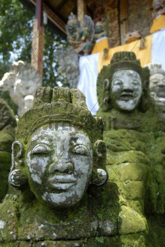 Bali Hinduism, old faces on moss-covered stone statues, Pura Griya Sakti Temple near Ubud, Bali, Indonesia, Southeast Asia, Asia