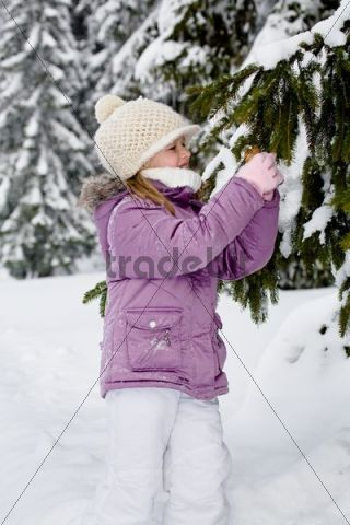 Girl in snow-covered forest