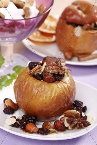 Christmas dish, baked apple with walnuts, raisins, almond paste and cinnamon stars