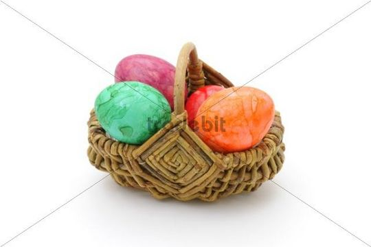 Basket with coloured Easter Eggs