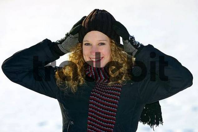 a young woman with a woolen scarf and a woolen cap