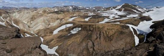 Brown volcanic landscape with snow-capped mountains and volcanoes, panoramic view, Landmannalaugar, Iceland, Europe