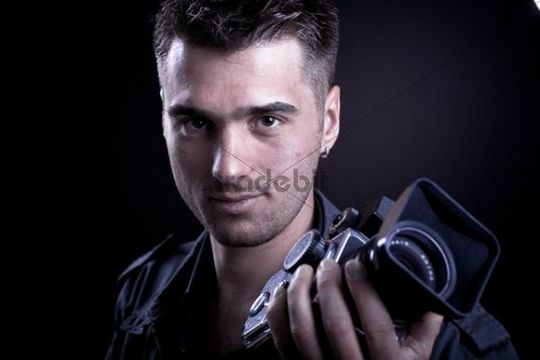 Young man with a medium format camera, portrait