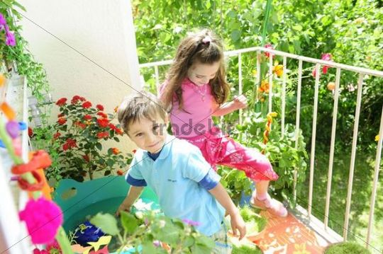 Boy and girl on the balcony