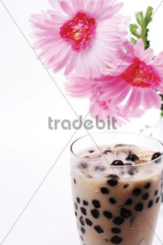 Pearl milk tea or Boba milk tea, drink made by adding boba balls, made from a mixture of tapioca and carrageenan powder, to shaken milk black tea