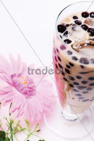 Pearl milk tea or boba milk tea, made by adding boba balls, made from a mixture of tapioca and carrageenan powder, to shaken milk black tea