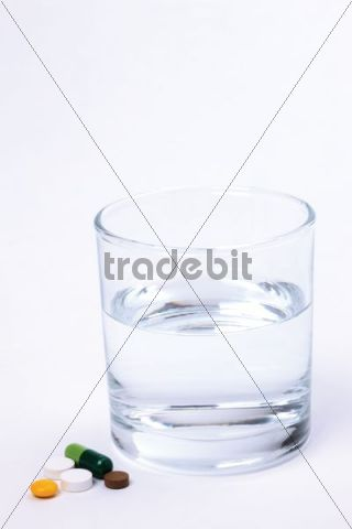 Tablets, pills, capsule, glass of water