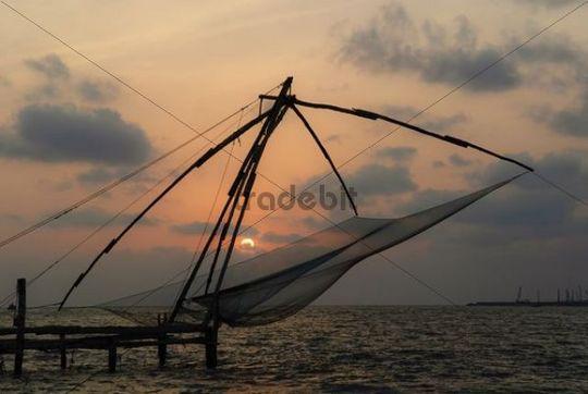 Chinese fishing net at sunset, Kochi, Kerala, India, Asia